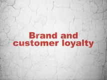 Advertising concept: Brand and Customer loyalty on wall background. Advertising concept: Red Brand and Customer loyalty on textured concrete wall background Royalty Free Stock Image