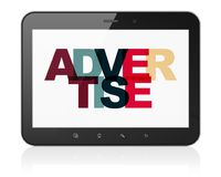 Advertising concept: Tablet Computer with Advertise on  display. Advertising concept: Tablet Computer with Painted multicolor text Advertise on display, 3D Royalty Free Stock Photography