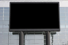 Advertising field. The big publicity board on a background of a glass wall Royalty Free Stock Image