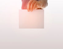 Advertising: Hand holding white empty paper Stock Photos