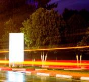 Light-box. Advertising lightbox on rainy boulevard royalty free stock images