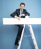 Advertising lucky businessman holding the board Stock Photos