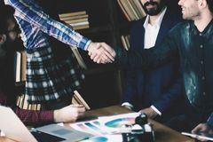 Advertising Manager with a handshake greets the customer. In a modern office Stock Image