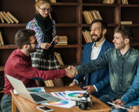 Advertising Manager with a handshake greets the customer Royalty Free Stock Photo