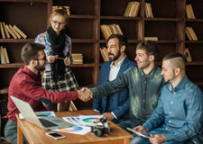 Advertising Manager with a handshake greets the customer Stock Photos