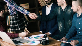 Advertising Manager with a handshake greets the customer Royalty Free Stock Image