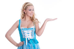 Advertising for Oktoberfest. Blonde makes advertising for the Oktoberfest. Woman showing on copy space royalty free stock photography