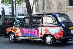 Advertising Priscilla in London. London taxi with advertisment for Royalty Free Stock Photos