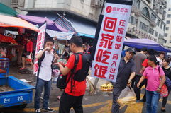 Advertising promotions in the open market. Advertising promotion, in the open market, the concept of publicity to go home to eat. In Shenzhen, china royalty free stock images