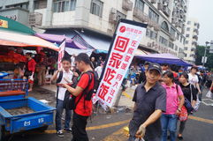 Advertising promotions in the open market. Advertising promotion, in the open market, the concept of publicity to go home to eat. In Shenzhen, china royalty free stock image