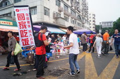 Advertising promotions in the open market. Advertising promotion, in the open market, the concept of publicity to go home to eat. In Shenzhen, china stock photography