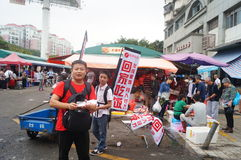 Advertising promotions in the open market. Advertising promotion, in the open market, the concept of publicity to go home to eat. In Shenzhen, china stock image
