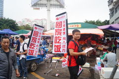 Advertising promotions in the open market. Advertising promotion, in the open market, the concept of publicity to go home to eat. In Shenzhen, china royalty free stock photos
