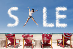 Advertising sale cloud and girl jump over beach chairs Royalty Free Stock Image