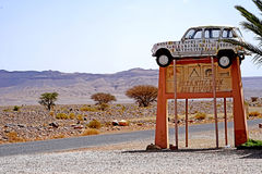 An advertising sign in the desert of Morocco Royalty Free Stock Images