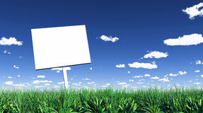 Advertising sign in field Stock Photo