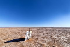Advertising sign in the middle of nowhere, Morocco Royalty Free Stock Image