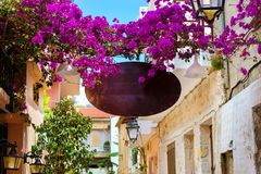 Advertising signboard on touristic street Rethymno. Decorated street advertising signboard on narrow touristic street in tourist routes. Walk around old resort Royalty Free Stock Photos