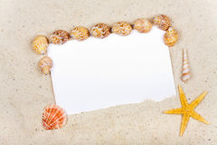 Advertising space on white Paper in the Sand Royalty Free Stock Photography