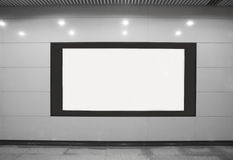 An advertising sreen. An advertising screen is in wall in a shopping mall royalty free stock image