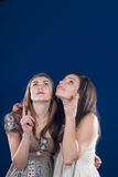 Advertising two beautiful young women showing Stock Photo