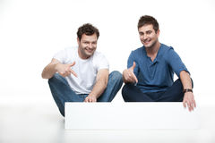 Advertising two young men Stock Image
