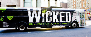 Advertising Wicked. Advertising the musical Wicked on a city bus in NYC Royalty Free Stock Photo