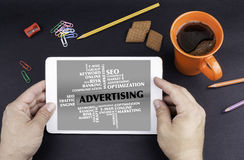 ADVERTISING word cloud. Text on tablet device stock images
