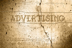 Advertising. Word advertising on wall with egyptian alphabet made in 2d software Stock Photos