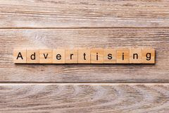 ADVERTISING word written on wood block. ADVERTISING text on wooden table for your desing, concept royalty free stock photo