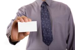 Advertisment. Businessman holding white card, copy space included stock photography