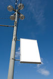 Advertisment panel 2. An advertisment panel fixed on a lights pole over a blue sky Stock Image