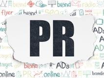 Advertizingbegrepp: PR på sönderriven pappers- bakgrund Royaltyfri Fotografi