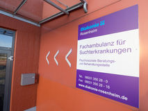 Advice center for addictive disorders. Sign infront of the entrance to the advice center for addictive disorders of the deaconry in Rosenheim - copy space to the Stock Photography