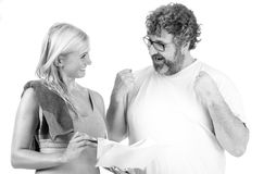 Advice on diet. Mid age men gets high five from personal trainer stock image