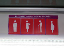 Advice notice. Notice of who should have preference to seats on local train, Alora, Andalucia Royalty Free Stock Photos