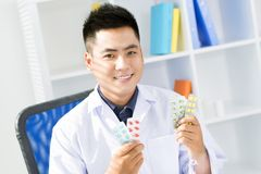 Advice of a pharmacist Stock Images