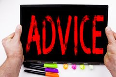 Advice text written on tablet, computer in the office with marker, pen, stationery. Business concept for Suggestion guidance conce. Pt white background with Stock Photos