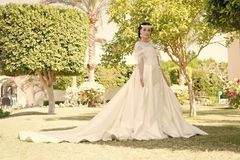 Advice and tips from wedding abroad experts. Fairytale dress. Things consider for wedding abroad. Bride adorable white. Wedding dress sunny day palm tree royalty free stock photography