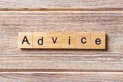 Advice word written on wood block. Advice text on table, concept stock photo