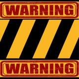 Advierta, amarillo - la muestra negra dice sobre el peligro Fotografía de archivo