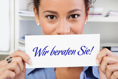 We advise you!. Woman with sign in hands stock image