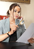 Adviser. Business woman looks on one document by magnifying glass Royalty Free Stock Photography