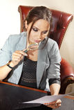 Adviser with magnifying glass Stock Images