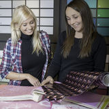 Advising costumer in hardware store. Salesperson advising costumer in hardware store royalty free stock images