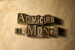 Advising for money - letterpress text sign Stock Photo