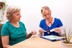 Advising a Senior on the dose of medication Royalty Free Stock Photo