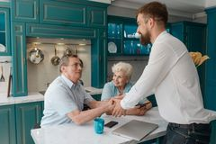 Advisor and clients shaking hands. Both came to an agreement and satisfied. Retirement planning and insurance stock photos