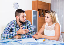 Advisor consulting struggling young woman. Banking agent having bad news for broken client indoors Stock Photography