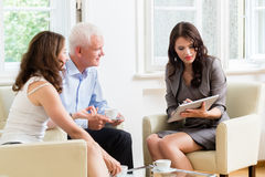 Advisor giving investment advice to senior couple Stock Photography